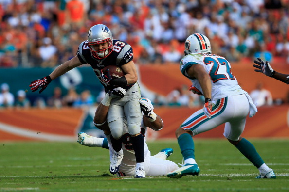 MIAMI GARDENS, FL - DECEMBER 02: Wide receiver Wes Welker #83 of the New England Patriots is tackled by defensive tackle Paul Soliai #96 of the Miami Dolphins at Sun Life Stadium on December 2, 2012 in Miami Gardens, Florida.  (Photo by Chris Trotman/Getty Images)
