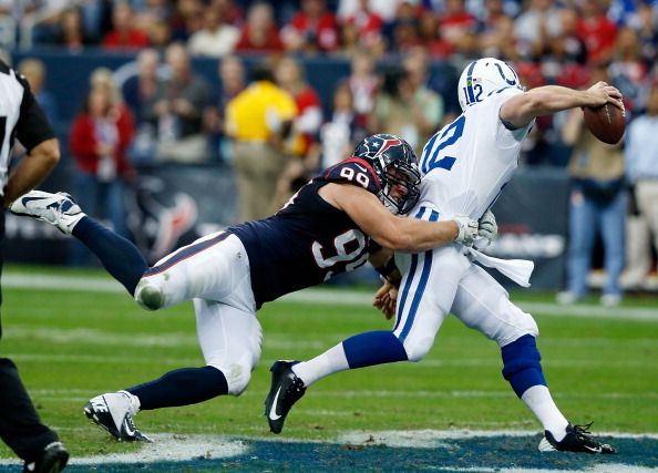 HOUSTON, TX - DECEMBER 16:  Andrew Luck #12 of the Indianapolis Colts is sacked by J.J. Watt #99 of the Houston Texans in the first half of during the game  at Reliant Stadium on December 16, 2012 in Houston, Texas.  (Photo by Scott Halleran/Getty Images)