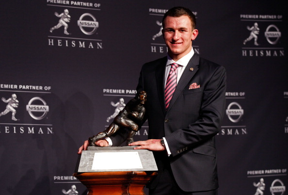 NEW YORK, NY - DECEMBER 08:  Quarterback Johnny Manziel of the Texas A&M University Aggies poses with the Heisman Memorial Trophy after being named the 78th Heisman Memorial Trophy Award winner at a press conference after at the Marriott Marquis on December 8, 2012 in New York City.  (Photo by Mike Stobe/Getty Images)