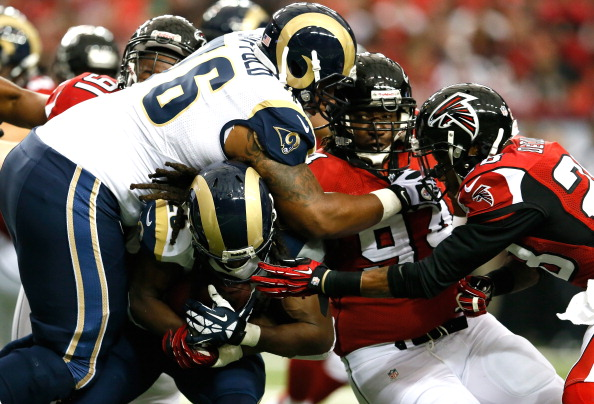 ATLANTA, GA - SEPTEMBER 15:  Daryl Richardson #26 of the St. Louis Rams is tackled by Peria Jerry #94 and Thomas DeCoud #28 of the Atlanta Falcons at Georgia Dome on September 15, 2013 in Atlanta, Georgia.  (Photo by Kevin C. Cox/Getty Images)