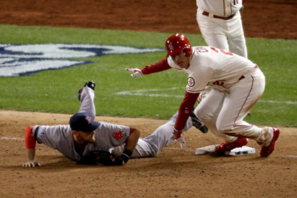 ST LOUIS, MO - OCTOBER 26:  Allen Craig #21 of the St. Louis Cardinals gets tripped up by Will Middlebrooks #16 of the Boston Red Sox during the ninth inning of Game Three of the 2013 World Series at Busch Stadium on October 26, 2013 in St Louis, Missouri.
