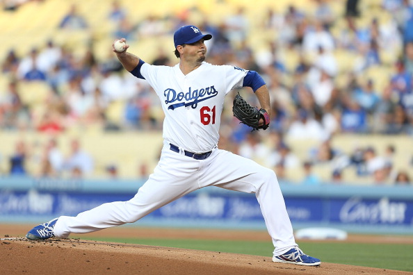 LOS ANGELES, CA - JUNE 26:  Josh Beckett #61 of the Los Angeles Dodgers pitches in the first inning against the St. Louis Cardinals at Dodger Stadium on June 26, 2014 in Los Angeles, California.  (Photo by Joe Scarnici/Getty Images)