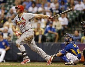 Matt Holliday #7 of the St. Louis Cardinals hits a solo home run to put the Cradinals up 7-6 in the top of the ninth inning against the Milwaukee Brewers at Miller Park on July 11, 2014 in Milwaukee, Wisconsin. (Photo by Mike McGinnis/Getty Images)