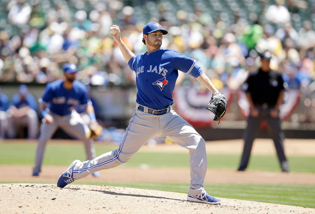 OAKLAND, CA - JULY 06:  Drew Hutchison #36 of the Toronto Blue Jays pitches against the Oakland Athletics at O.co Coliseum on July 6, 2014 in Oakland, California.