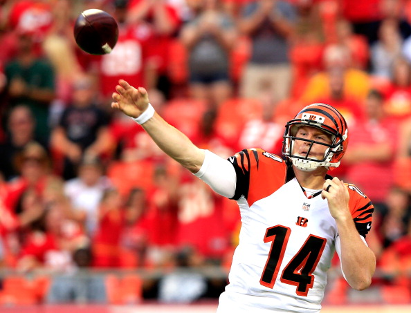 Andy Dalton #14 of the Cincinnati Bengals drops back against the Kansas City Chiefs during the first quarter at Arrowhead Stadium on August 7, 2014 in Kansas City, Missouri.  (Photo by Jamie Squire/Getty Images)