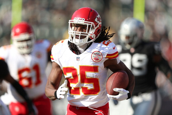 Jamaal Charles #25 of the Kansas City Chiefs runs for a touchdown against the Oakland Raiders at O.co Coliseum on December 15, 2013 in Oakland, California.  (Photo by Jed Jacobsohn/Getty Images)