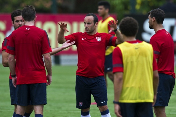"""US national football team player Landon Donovan (C) gestures during a training session at the Sao Paulo FC training centre in Sao Paulo, Brazil on January 14, 2014. The US national football squad kicked off a 12-day training session in Sao Paulo on Tuesday as part of their """"dry run"""" for the upcoming World Cup. (credit: NELSON ALMEIDA/AFP/Getty Images)"""