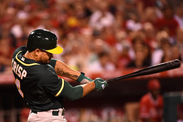 ANAHEIM, CA - AUGUST 28:  Coco Crisp #4 of the Oakland Athletics hits an RBI single in the fifth inning against the Los Angeles Angels of Anaheim at Angel Stadium of Anaheim on August 28, 2014 in Anaheim, California.
