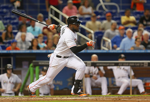 MIAMI, FL - AUGUST 20: Marcell Ozuna #13 of the Miami Marlins hits during a game against the Texas Rangers at Marlins Park on August 20, 2014 in Miami, Florida.