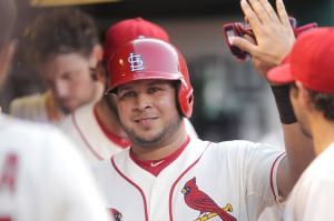 St. Louis Cardinals Jhonny Peralta smiles as he enters the dugout after scoring in the fifth inning against the New York Mets at Busch Stadium in St. Louis on July 18, 2015. St. Louis defeated New York 12-2. Photo by Bill Greenblatt/UPI
