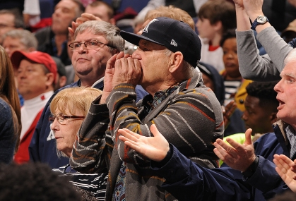 Actor Bill Murray cheers on Xavier from behind their bench as they play Wisconsin in the NCAA Division 1 Men's Basketball Championship at the Scottrade Center in St. Louis on March 20, 2016. Murray's son Luke is an assistant coach with the team. Wisconsin defeated Xavier, 66-63.    Photo by Doug Devoe/UPI