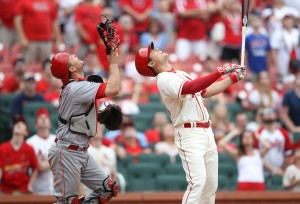 St. Louis Cardinals Aledmys Diaz and Cincinnati Reds catcher Devin Mesoraco watch a ball hit straight up that would end the game at Busch Stadium in St. Louis on April 16, 2016.Cincinnati won the game 9-8. Photo by Bill Greenblatt/UPI