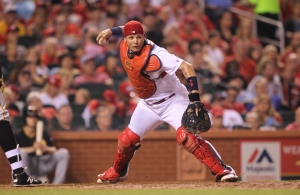 St. Louis Cardinals Yadier Molina fakes a throw to first base in the sixth inning against the Piuttsburgh Pirates at Busch Stadium in St. Louis on July 6, 2016. Photo by Bill Greenblatt/UPI