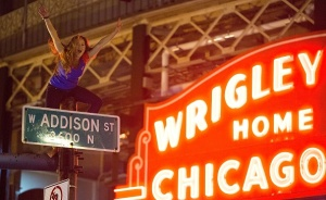 A Chicago fan sits on top a street pole as people gather to watch the Chicago Cubs take on the Cleveland Indians in Cleveland in game seven of the 2016 World Series, outside Wrigley Field in Chicago, Illinois late on November 2, 2016. Ending America's longest sports title drought in dramatic fashion, the Chicago Cubs captured their first World Series since 1908 by defeating the Cleveland Indians 8-7 in a 10-inning thriller that concluded early on November 3. / AFP / Tasos Katopodis (Photo credit should read TASOS KATOPODIS/AFP/Getty Images)