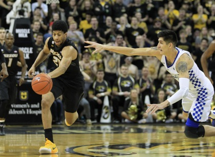 Missouri Tigers Jordan Barnett steals the basketball from Kentucky Wildcats Derek Willis in the first half at the Mizzou Arena in Columbia, Missouri on February 21, 2017.  Photo by Bill Greenblatt/UPI